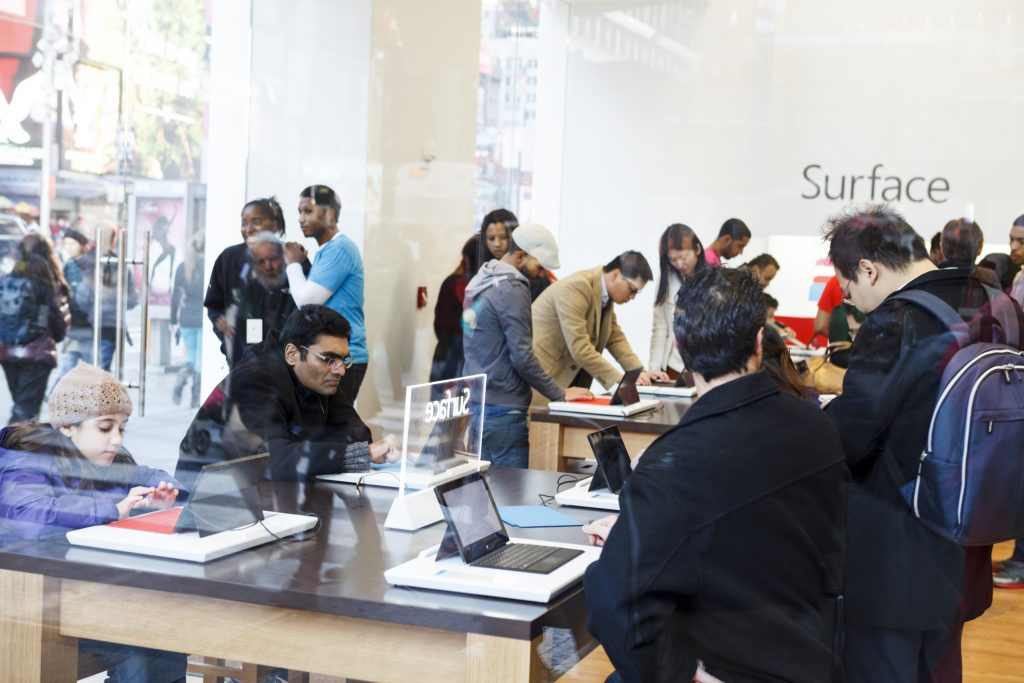 Group of people working on Surface laptops