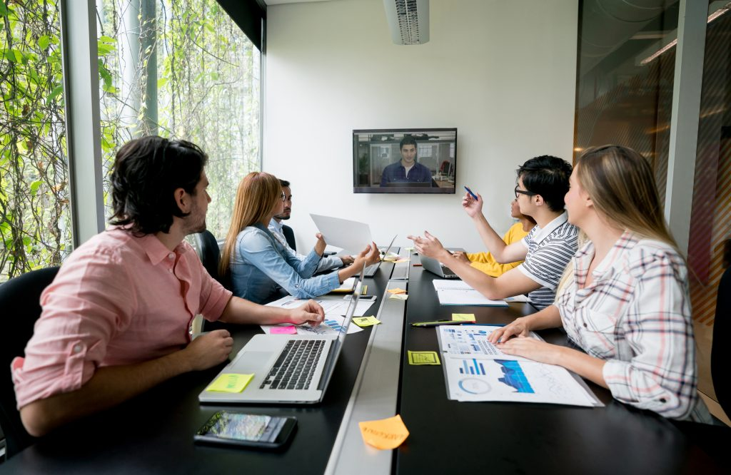 Group of people using a video conference system